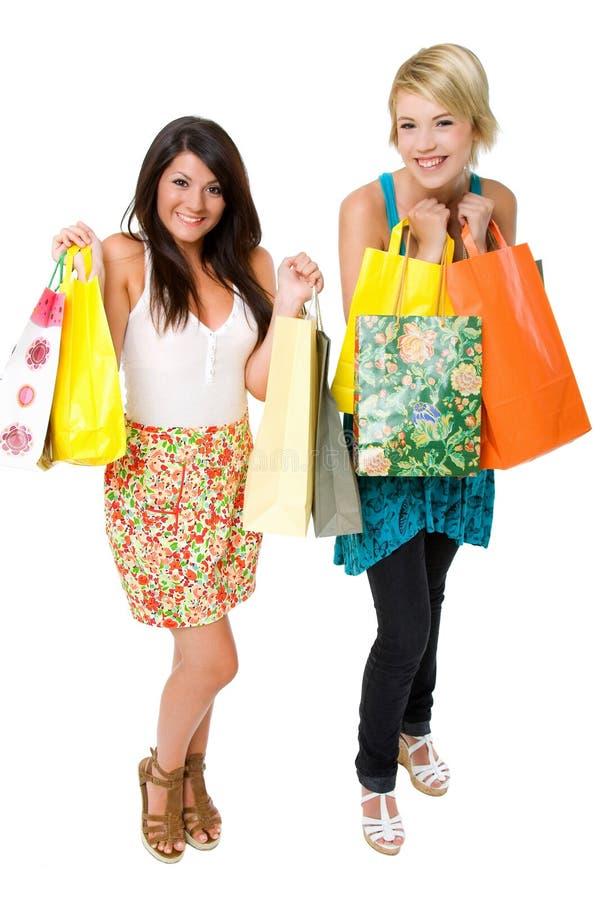 Einkauf mit zwei schöner jungen Frauen. stockfoto