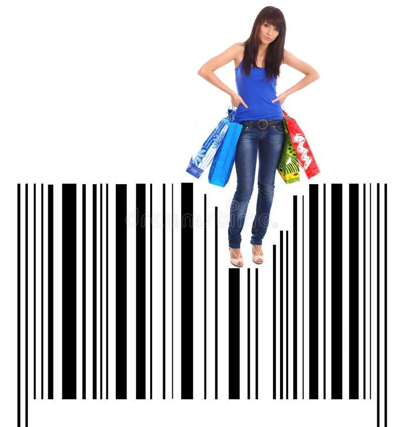 Einkaufen-Frau auf Strichkodehintergrund stockfoto