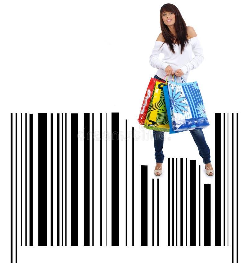 Einkaufen-Frau auf Strichkodehintergrund lizenzfreies stockbild