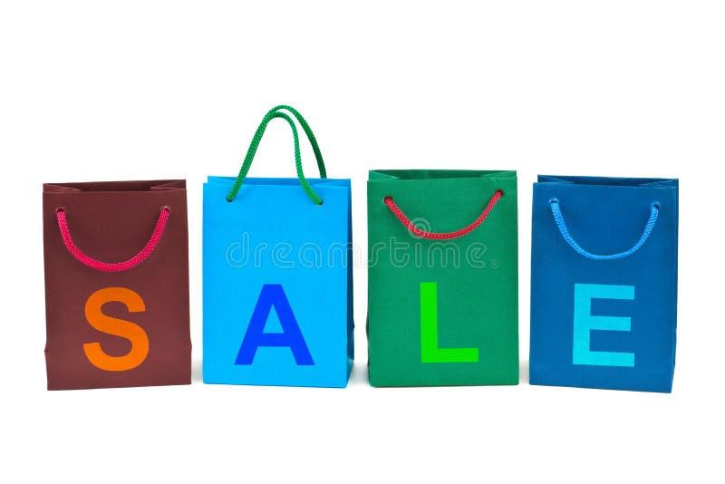 Einkaufenbeutel und Wort Verkauf stockbilder