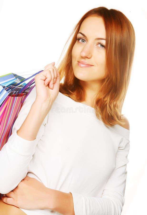 Einkaufenfrauenlächeln. stockfotografie