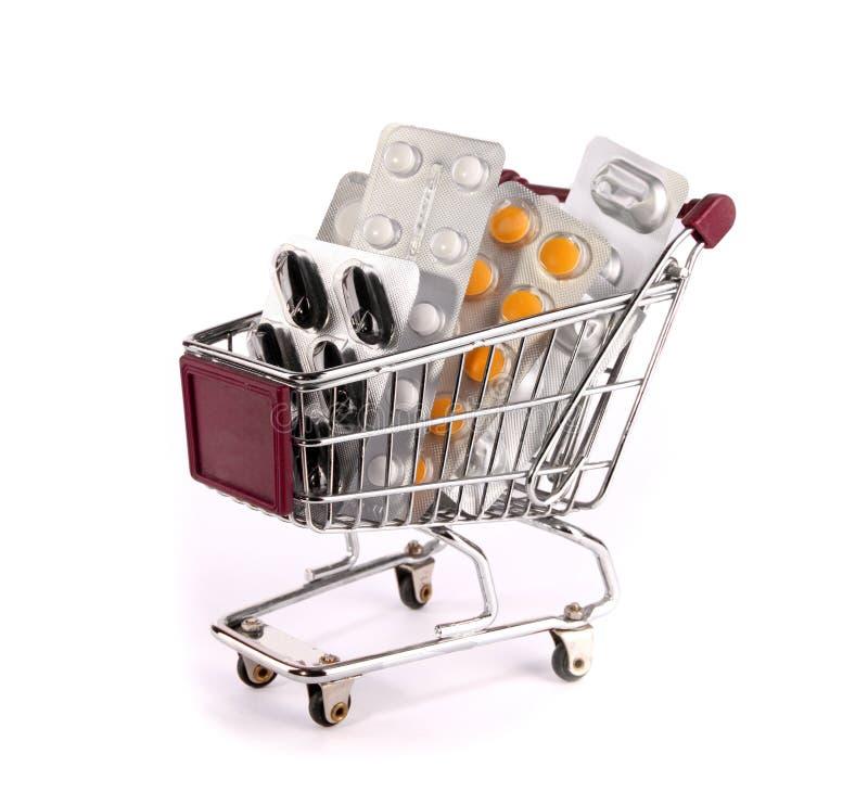 Einkaufenlaufkatze mit Pillen lizenzfreie stockbilder
