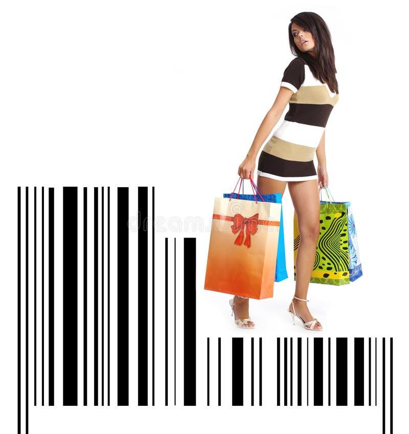Einkaufenmädchen mit Beutel auf Strichkode lizenzfreie stockfotografie