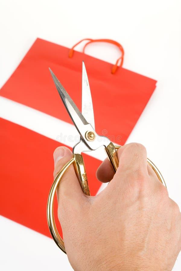 Einkaufstasche und scissor stockbilder