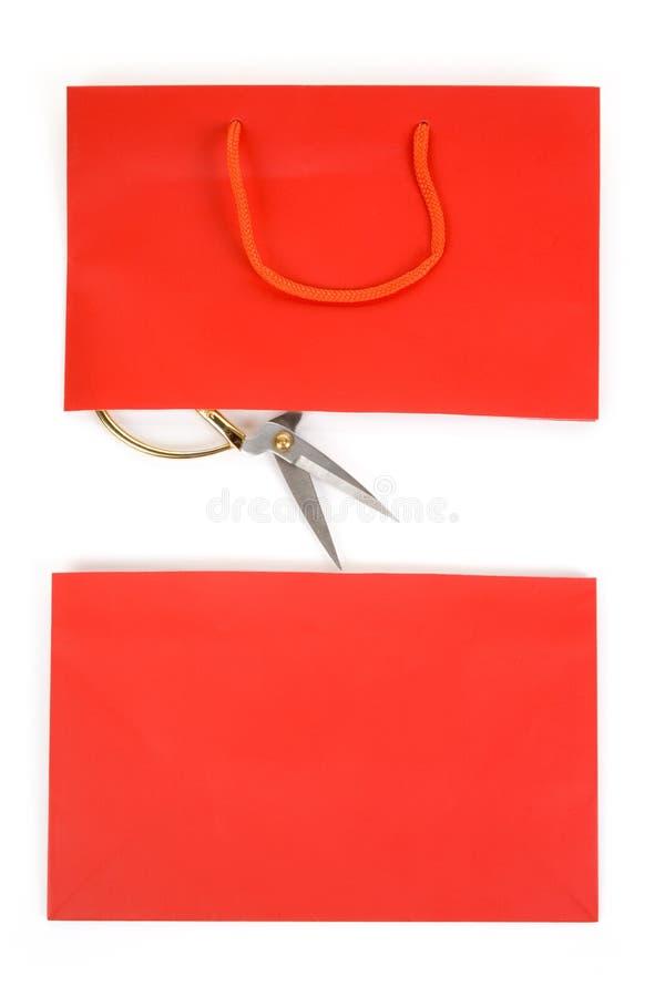 Einkaufstasche und scissor lizenzfreies stockbild