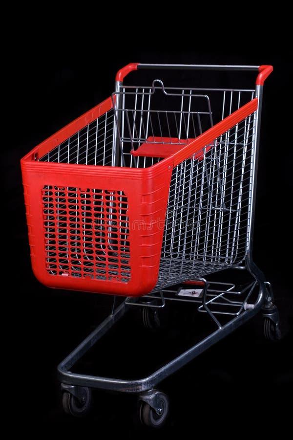 Einkaufswagen auf schwarzem Hintergrund lizenzfreies stockbild