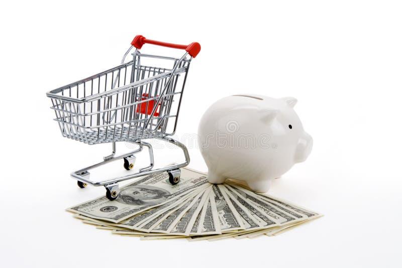 Einkaufswagen und Piggy Querneigung lizenzfreie stockbilder