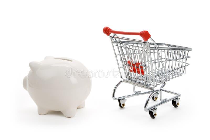 Einkaufswagen und Piggy Querneigung lizenzfreies stockbild