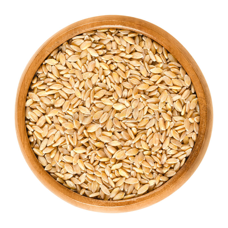 Free Einkorn Wheat In Wooden Bowl Over White Royalty Free Stock Images - 91388319