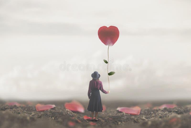 Einsame romantische Frau hält ein riesiges Blumenblatt hergestellt zum Herzen lizenzfreie stockfotos