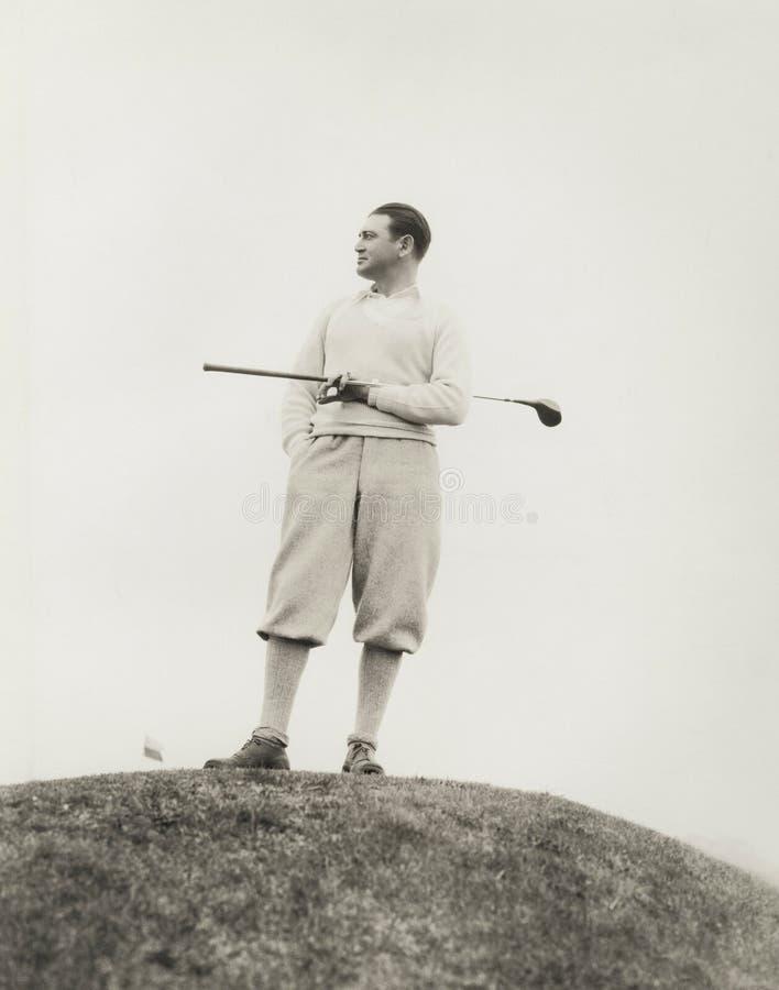 Einsamer Golfspieler stockfotos