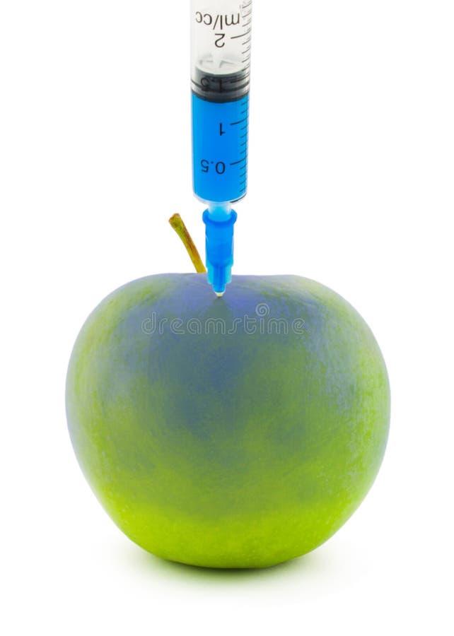 Einspritzung in einem Apfel lizenzfreies stockbild