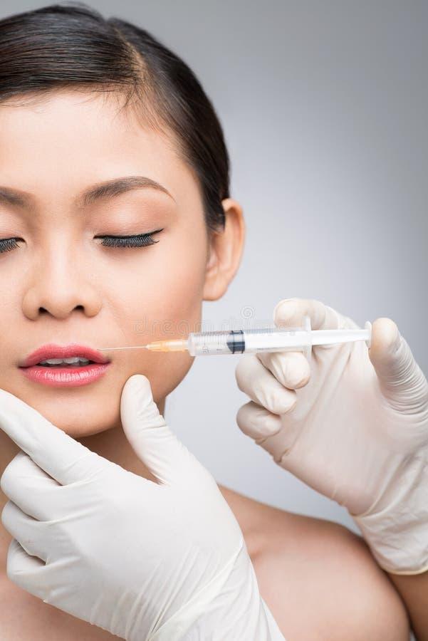 Einspritzung von botox stockbild