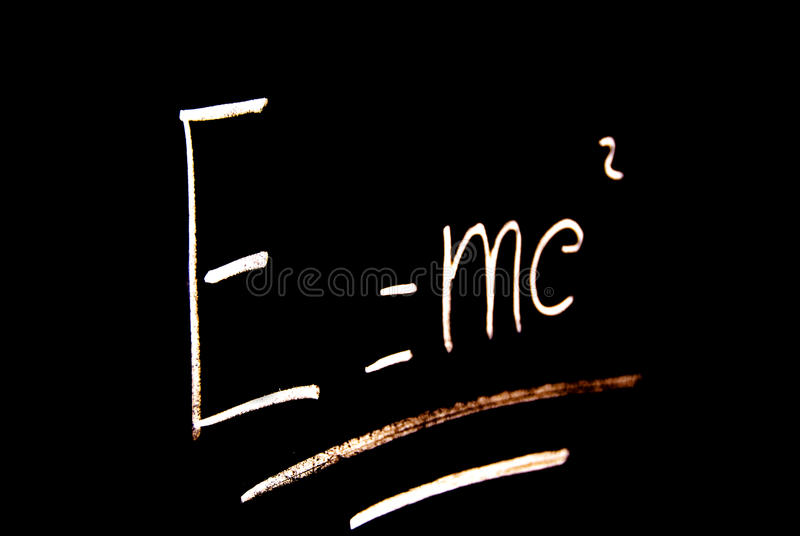 Einstein formula. The Einstein formula of relativity on a school blackboard - E = mc2 - physics or mathematical concept royalty free stock photo