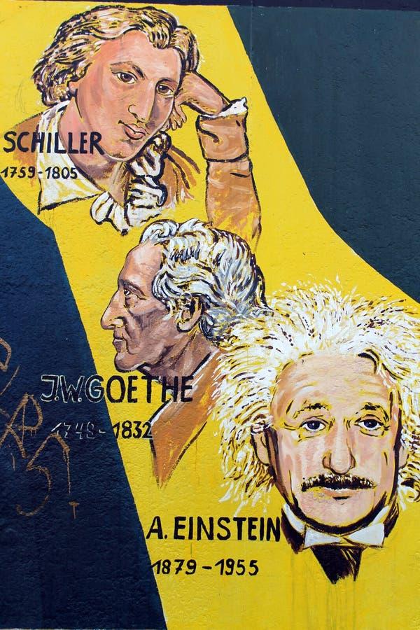 Einstein Schiller, Goethe drawed i den Berlin väggen. royaltyfri fotografi