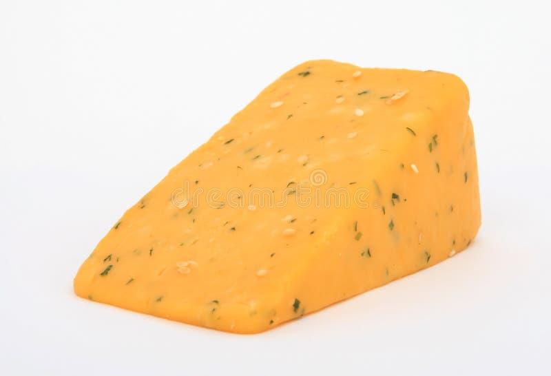 Einzelne Scheibe des gelben Käses lizenzfreie stockfotos