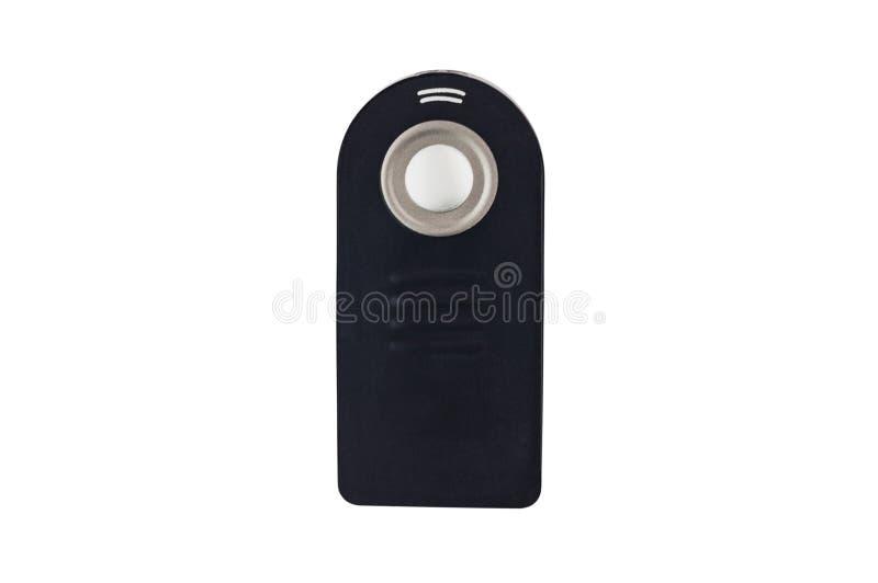 Einzelne schwarze Plastikfernbedienung mit einem Knopf für Garagentor oder anderen Toren lokalisiert auf weißem Hintergrund stockfoto