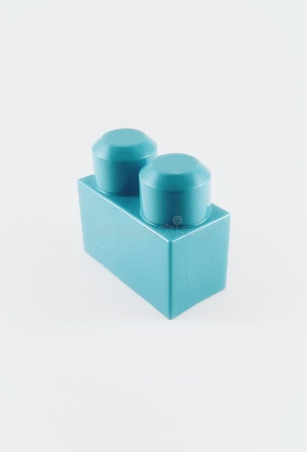 Einzelner blauer Baustein lizenzfreie stockbilder