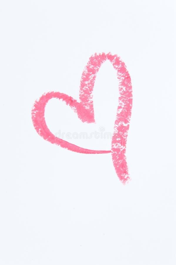 Einzelnes rosa Lippenstift-Herz auf Weißbuch stockfoto
