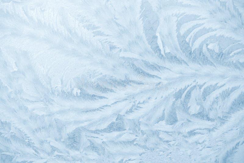 Eisblumen auf Fensterglas in der Wintersaison Bereiftes Glas-Beschaffenheit Hintergrund für eine Einladungskarte oder einen Glück stockbild