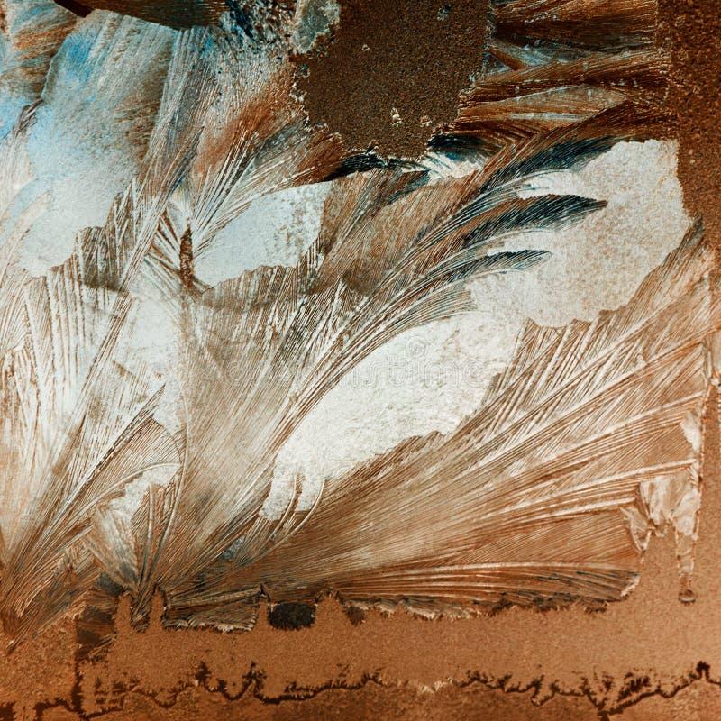 Eisblumen auf Glas lizenzfreie stockfotos
