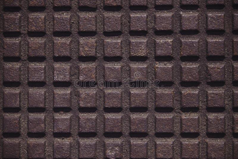 Eisenplatte mit einem karierten Muster stockfotografie