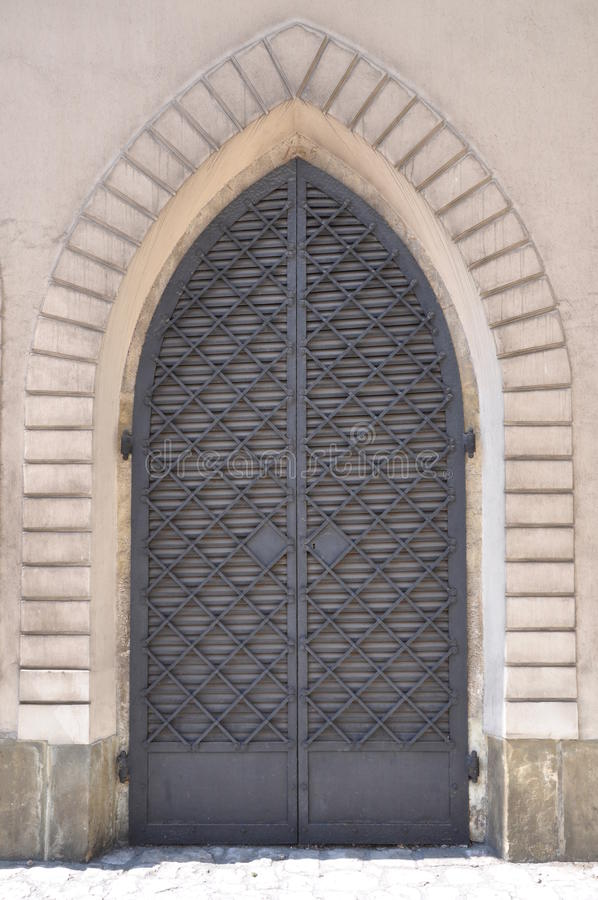 Eisentür und Steinwand stockfotos