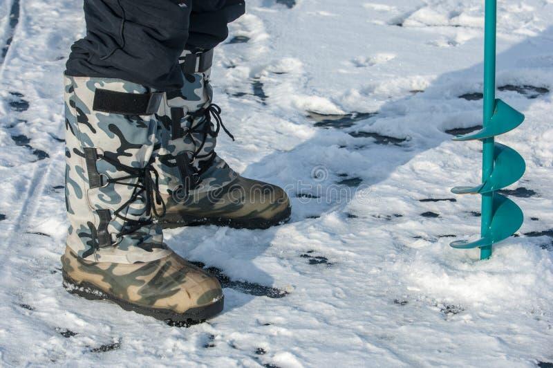 Eisschrauben für die Fischerei lizenzfreies stockbild