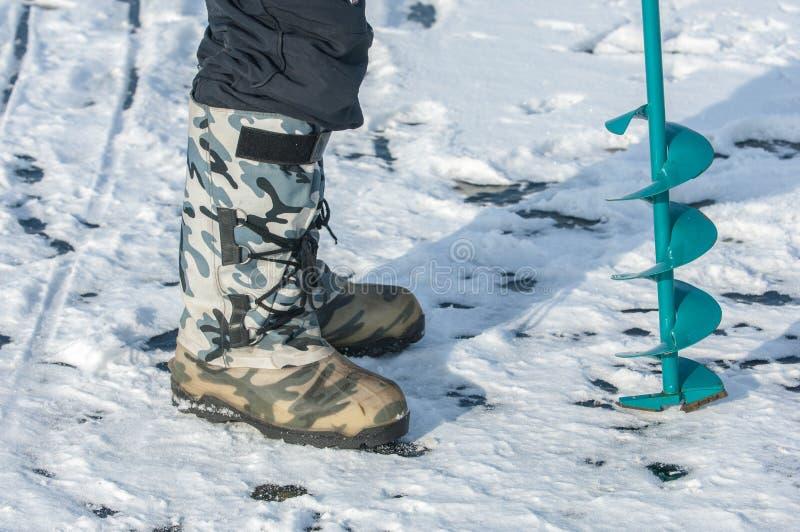 Eisschrauben für die Fischerei lizenzfreie stockbilder