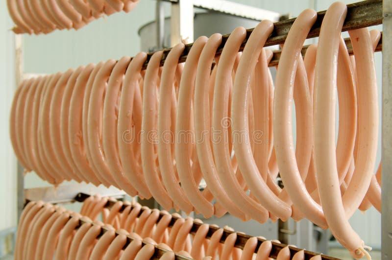 Ejecución de la salchicha en el almacén fotografía de archivo
