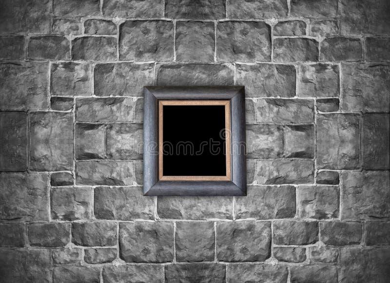 Ejecución del marco en la pared de ladrillo de piedra fotografía de archivo