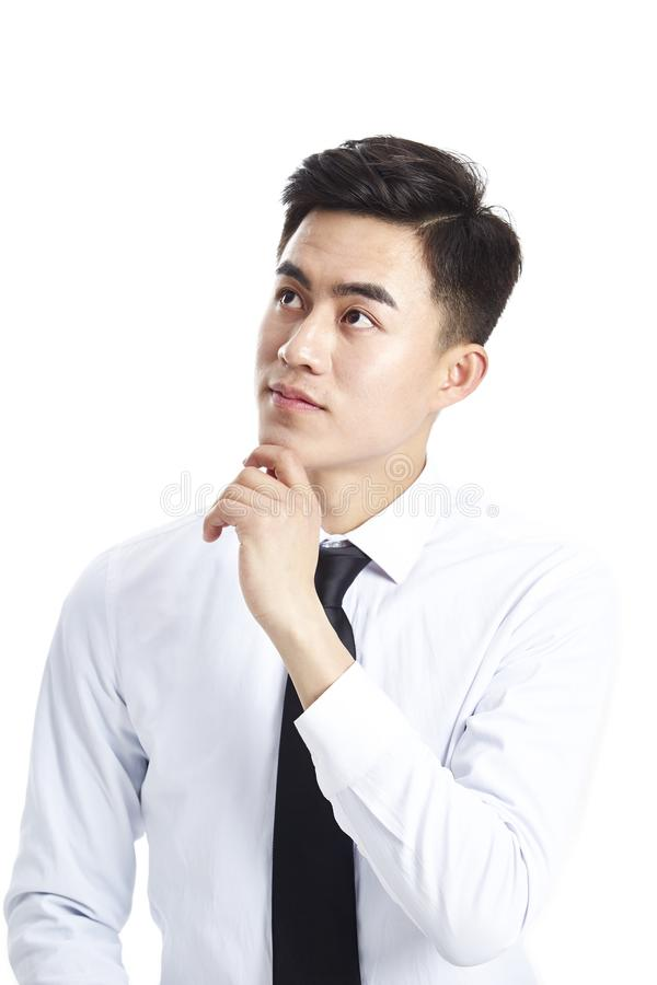 Ejecutivo empresarial asiático que mira para arriba de pensamiento fotos de archivo libres de regalías
