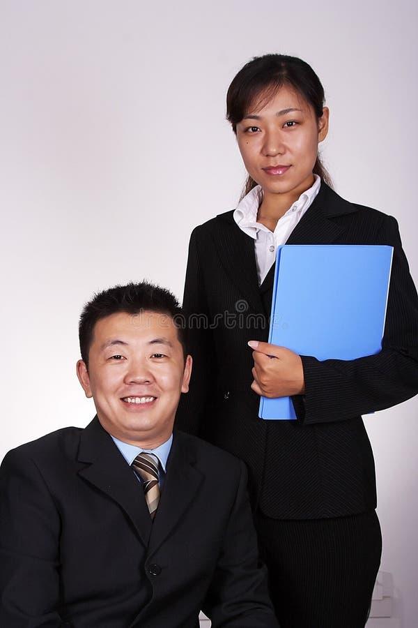 Ejecutivo y secretaria asiáticos imágenes de archivo libres de regalías