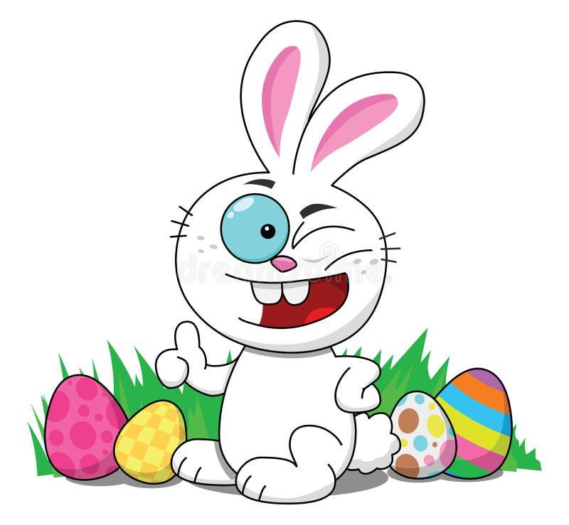 Conejito de pascua que guiña con los huevos de Pascua imagenes de archivo