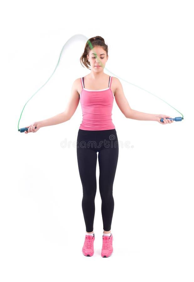 Ejercicio de la mujer del deporte con la cuerda imágenes de archivo libres de regalías