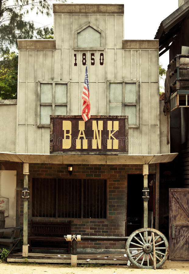 Ejerza la actividad bancaria en el oeste salvaje imágenes de archivo libres de regalías