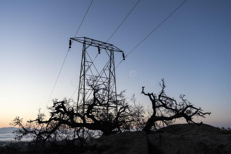 Ek och Los Angeles Electric Power tornsoluppgång royaltyfri foto