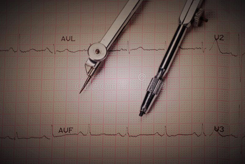 EKG Printout And Compasses Royalty Free Stock Photos