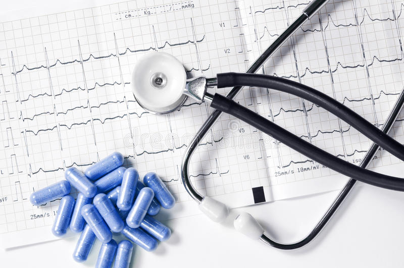 Ekg with stethoscope and pills royalty free stock photo