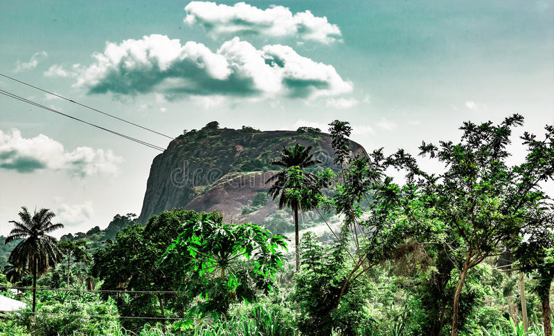 Ekiti hills along Iyin road in Ado Ekiti Nigeria. One of the many hills in Ado Ekiti in Ekiti State Nigeria Africa. A famous tourist attraction whose potential stock photos