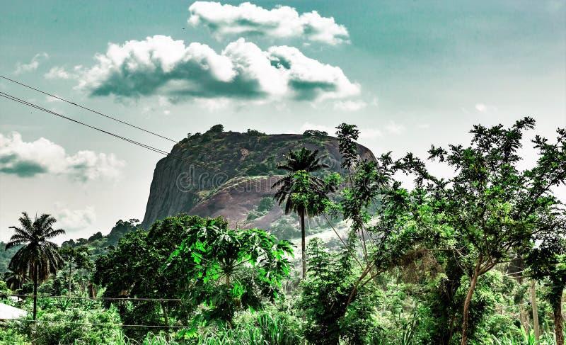 Ekiti hills along Iyin road in Ado Ekiti Nigeria. One of the many hills in Ado Ekiti in Ekiti State Nigeria Africa. A famous tourist attraction whose potential stock photos
