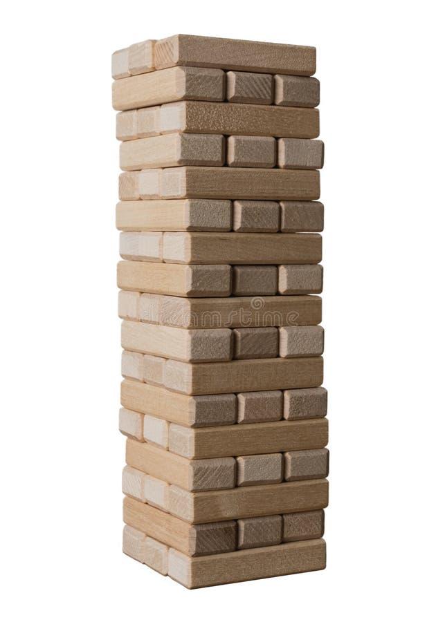 Elévese de los bloques de madera para el juego del jenga aislado en el fondo blanco Concepto de riesgo y de estrategia para guard imágenes de archivo libres de regalías