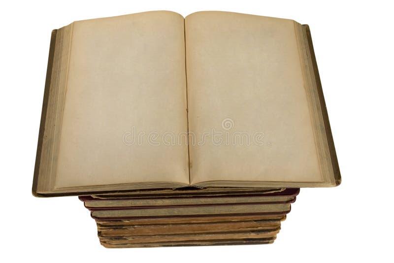 Elévese de los libros viejos con las paginaciones en blanco abiertas fotografía de archivo libre de regalías