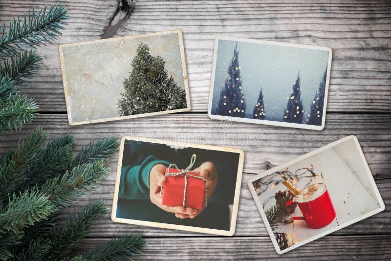 El álbum de foto en la conmemoración y la nostalgia en invierno de la Navidad sazonan en la tabla de madera foto de archivo
