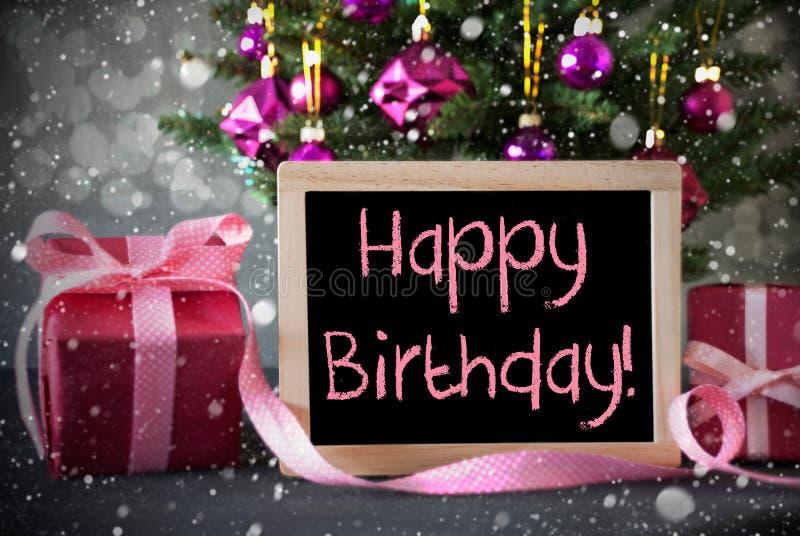 El árbol con los regalos, copos de nieve, Bokeh, manda un SMS a feliz cumpleaños fotografía de archivo