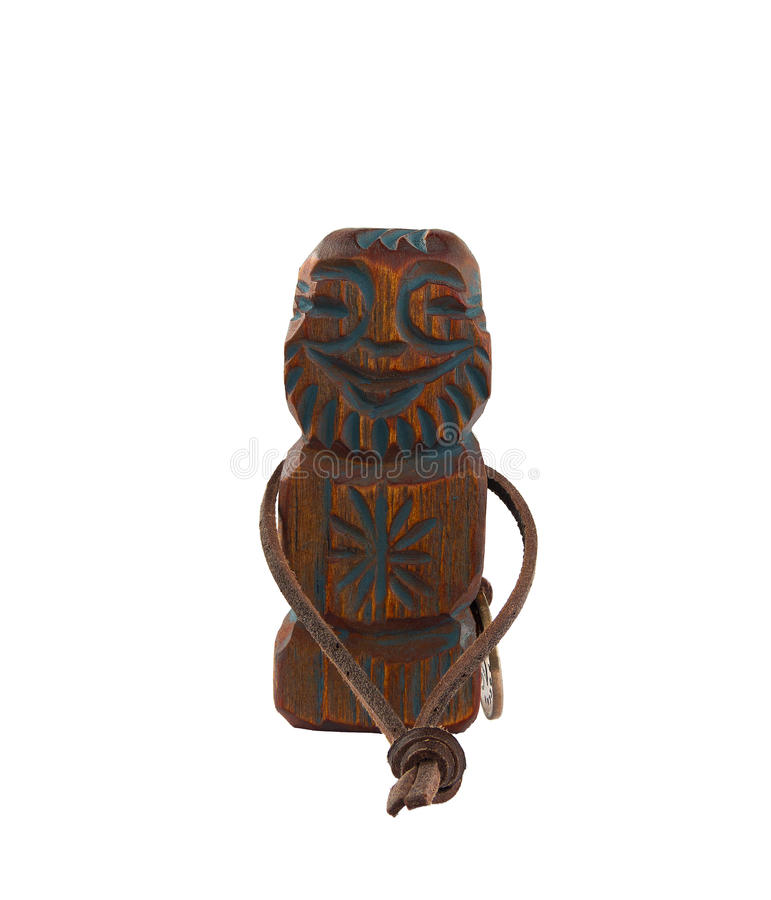 El ídolo de madera tallado es un símbolo de la riqueza, prosperidad y bien-es imagenes de archivo