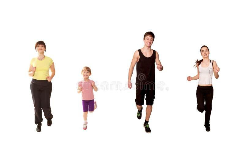 El activar de la familia, corriendo, entrenamiento de la aptitud. imagenes de archivo