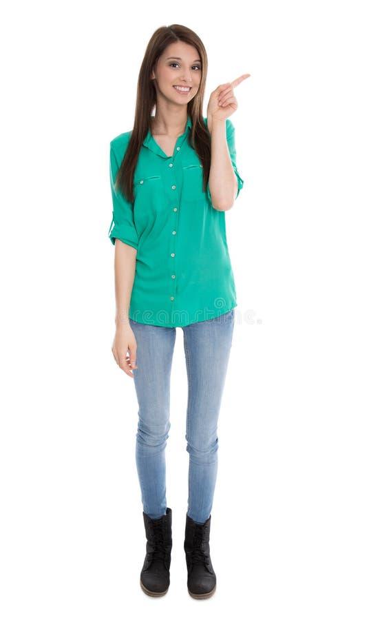 El adolescente en camiseta verde está señalando con el finger. foto de archivo libre de regalías