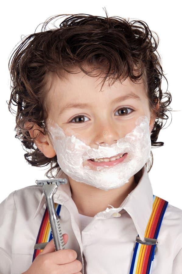 El afeitar adorable del niño imagen de archivo libre de regalías