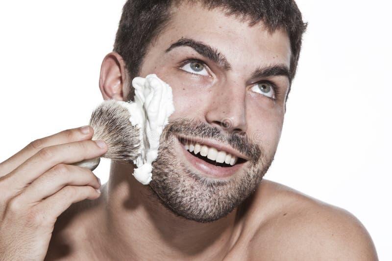 El afeitar del hombre joven imágenes de archivo libres de regalías